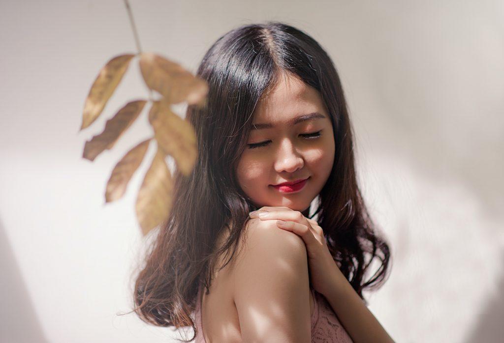 Lady appreciating clear skin