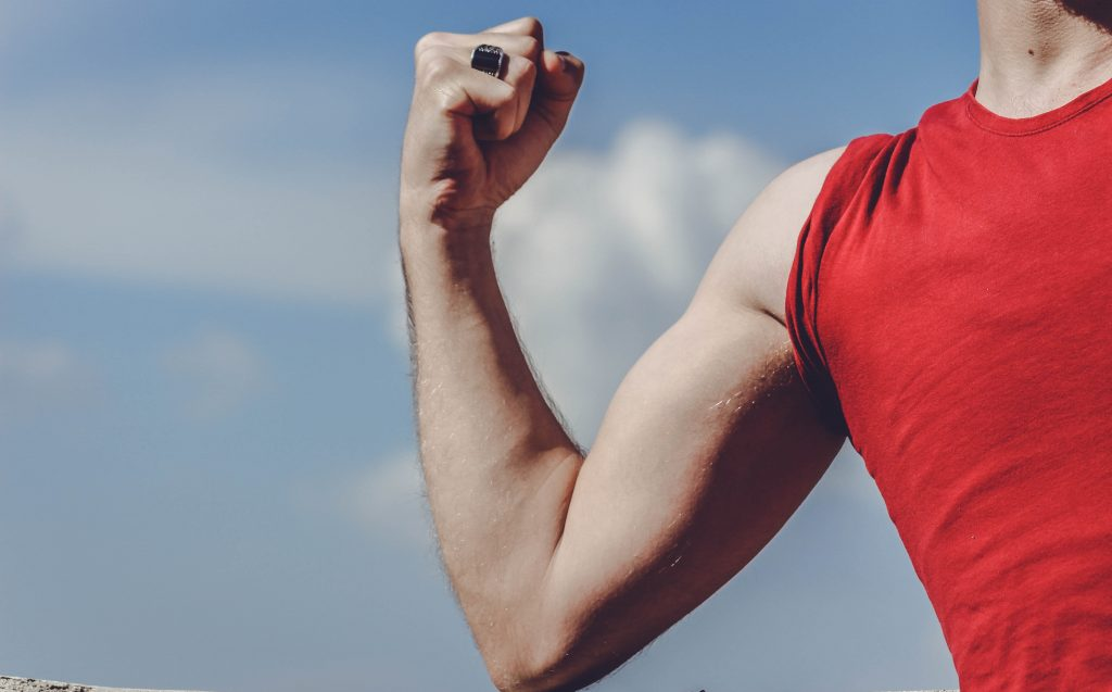 Red shirt man showing muscles